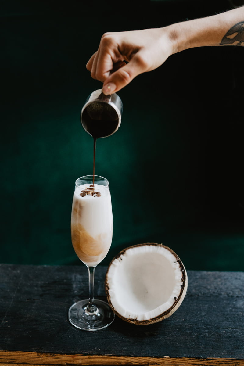 Food photography in natural light. Cocktail with rum, coconut and coffee served in an asian restaurant.