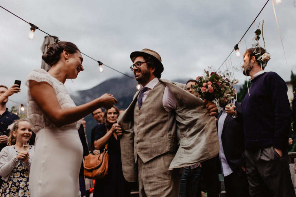 First dance in the terrace of a hotel in Champery, Switzerland. Just married happy couple in Swiss Alps.