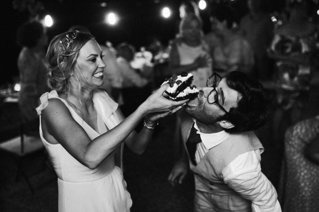 sharing a cake during a wedding in Tuscany